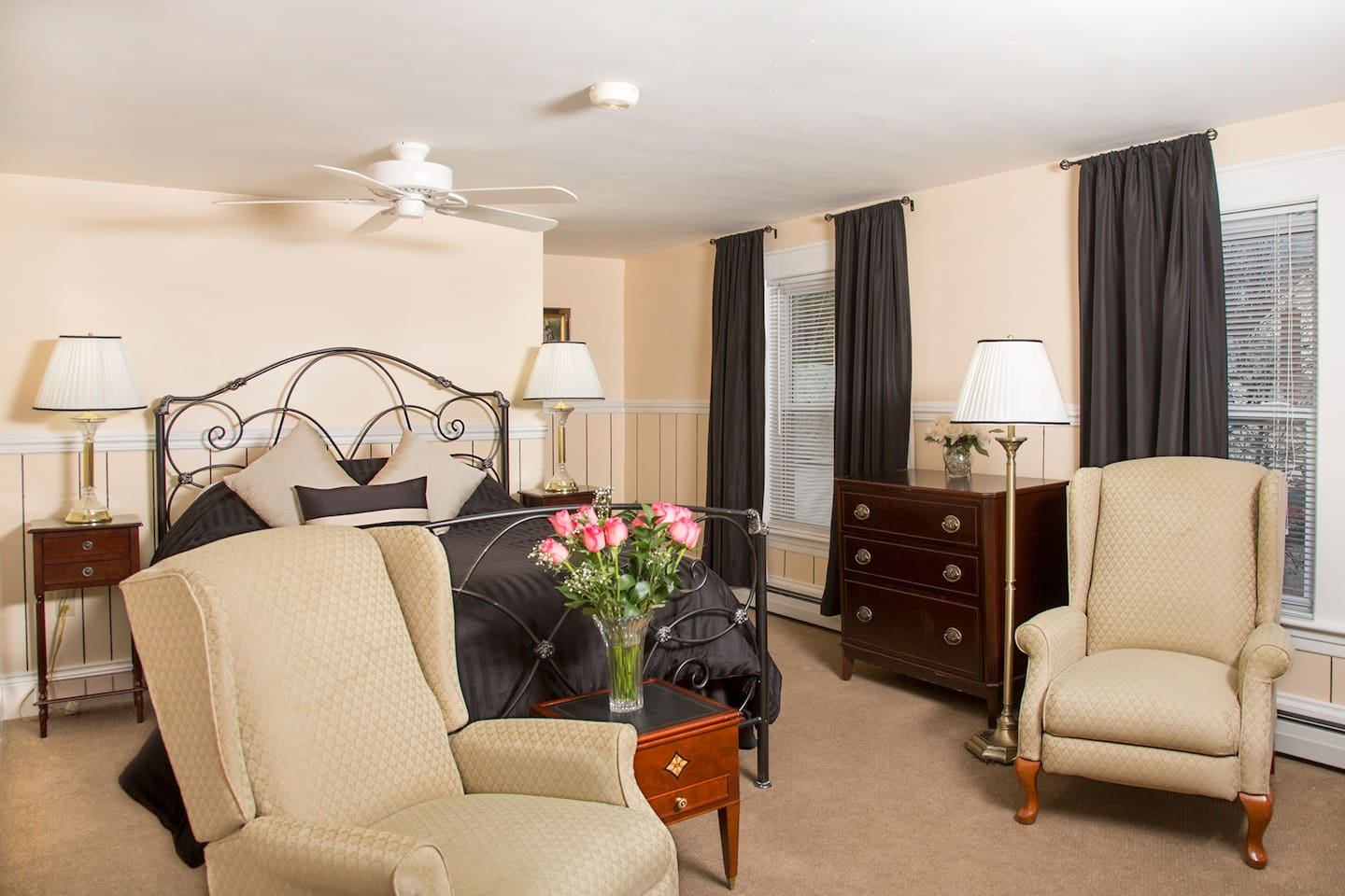 Adams Suite - elegant sitting room with reclining armchairs and romantic fireplace