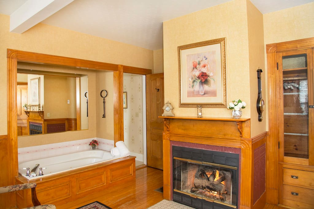 Monroe Suite - romantic fireplace with wood surround and double whirlpool bath