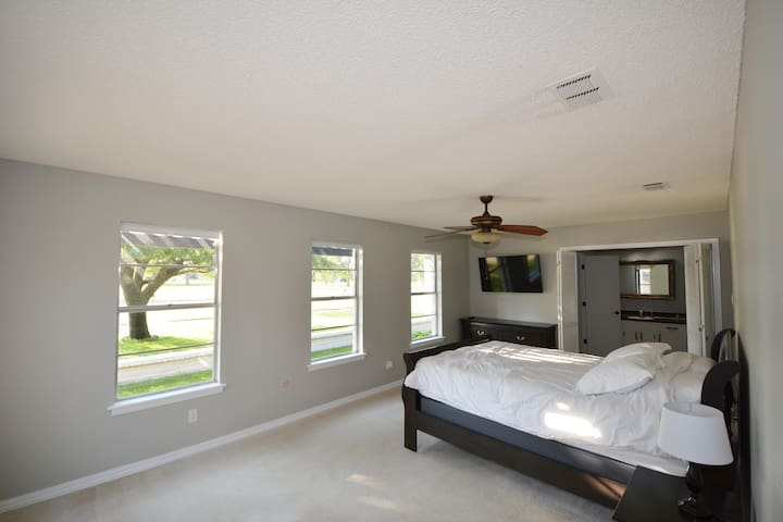 """Extra large master bedroom with golf course views. Full motion TV mount and 49"""" smart TV and large closet with hangers."""