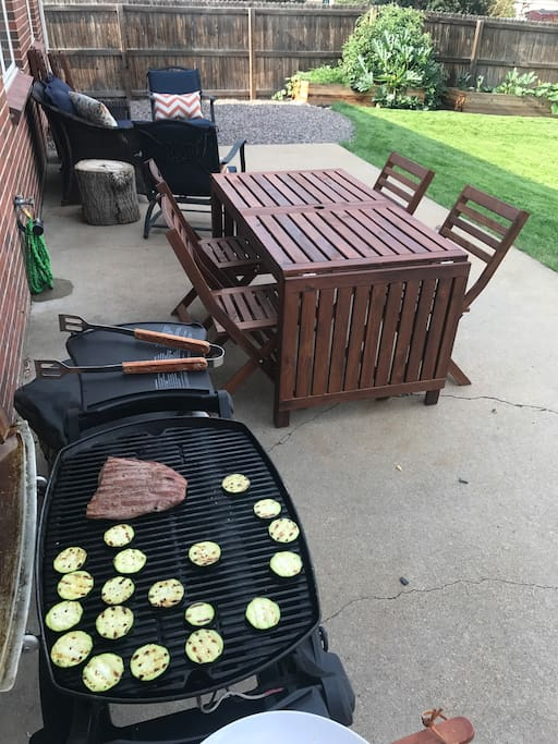 Our new backyard remodel includes outdoor seating, lights, a grill, and a garden. Guests can feel free to make a salad from our lettuce, tomatoes, and peppers - all grown with love!