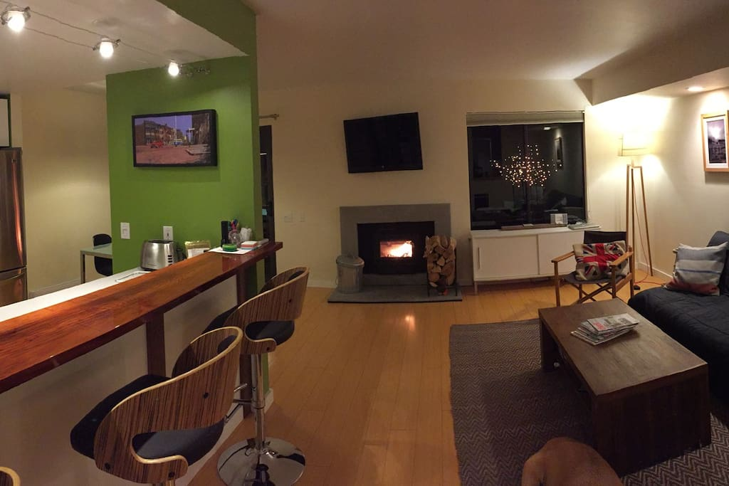 Open plan- living room, breakfast bar, dining area, kitchen. Real fire