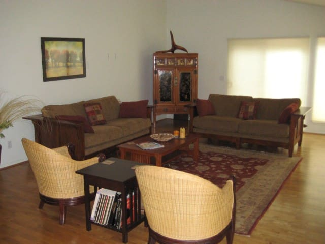 This very comfortable living room setting includes a TV in the beautiful armoire in the back corner.