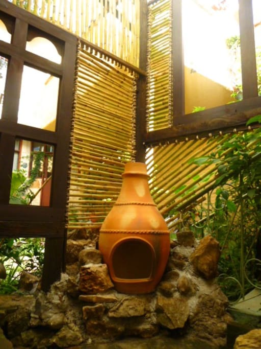 outdoor fire place in bamboo room