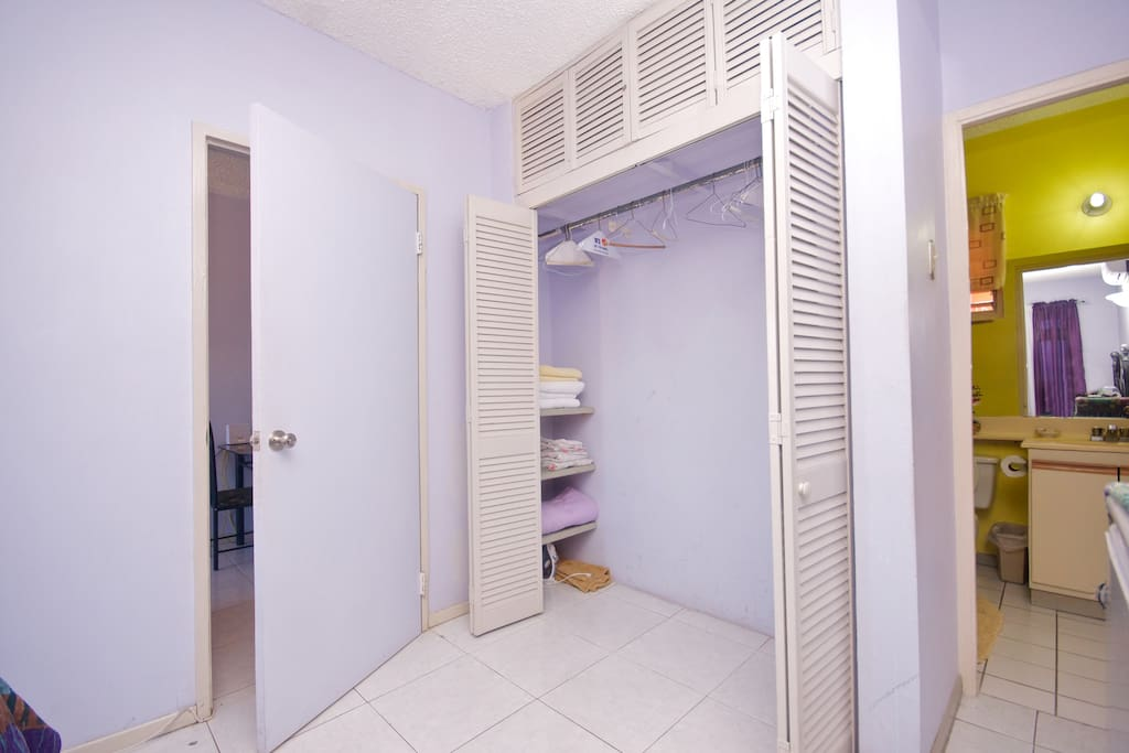 Large Closet -  - has storage for bed linen, towels, iron board and iron- picture includes a partial view of the bathroom..