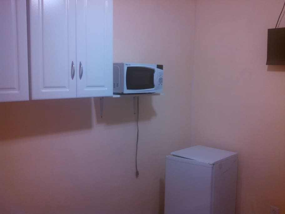 microwave and small private fridge