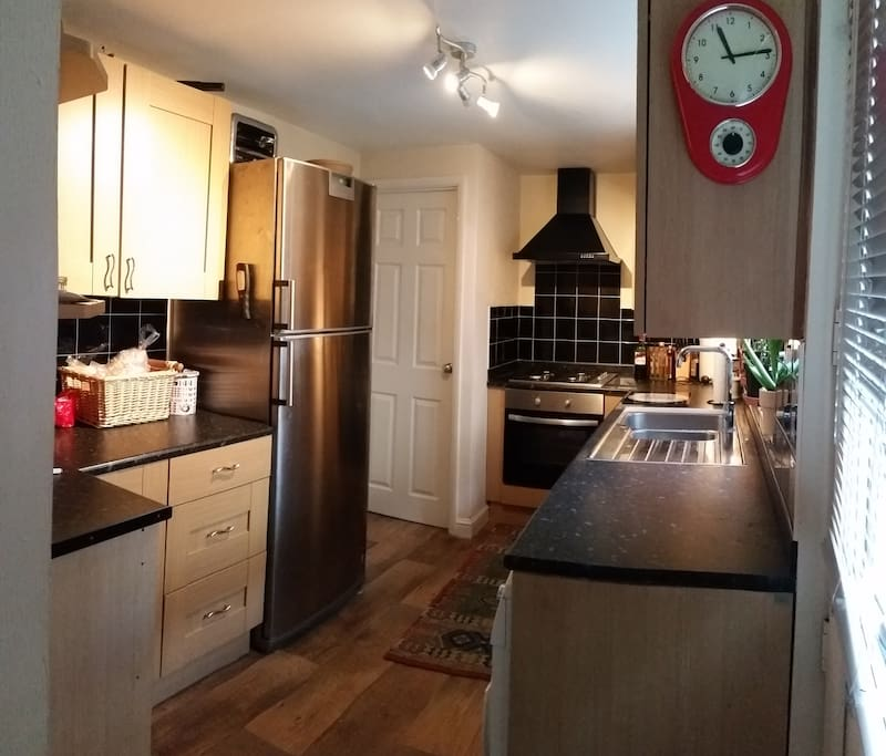 Nice kitchen with washing machine and tumble dryer facilities.
