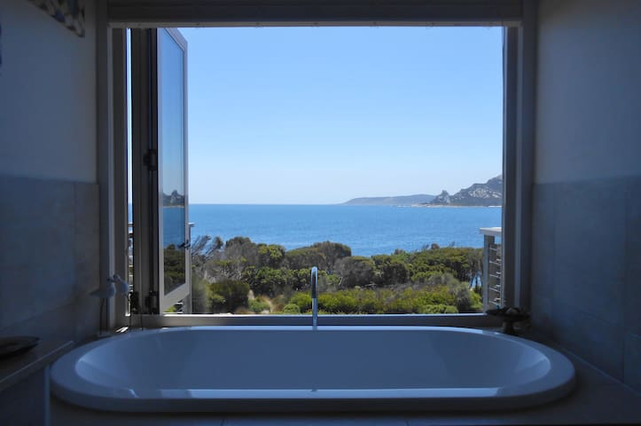 The bath in the ensuite with a fabulous fold back window and the view