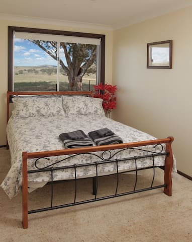 Double bedroom with a country view
