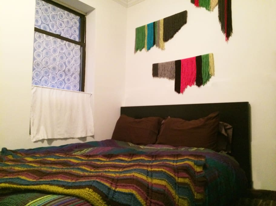 Comfortable queen size bed with down comforter, plenty of extra blankets and windows for fresh air!