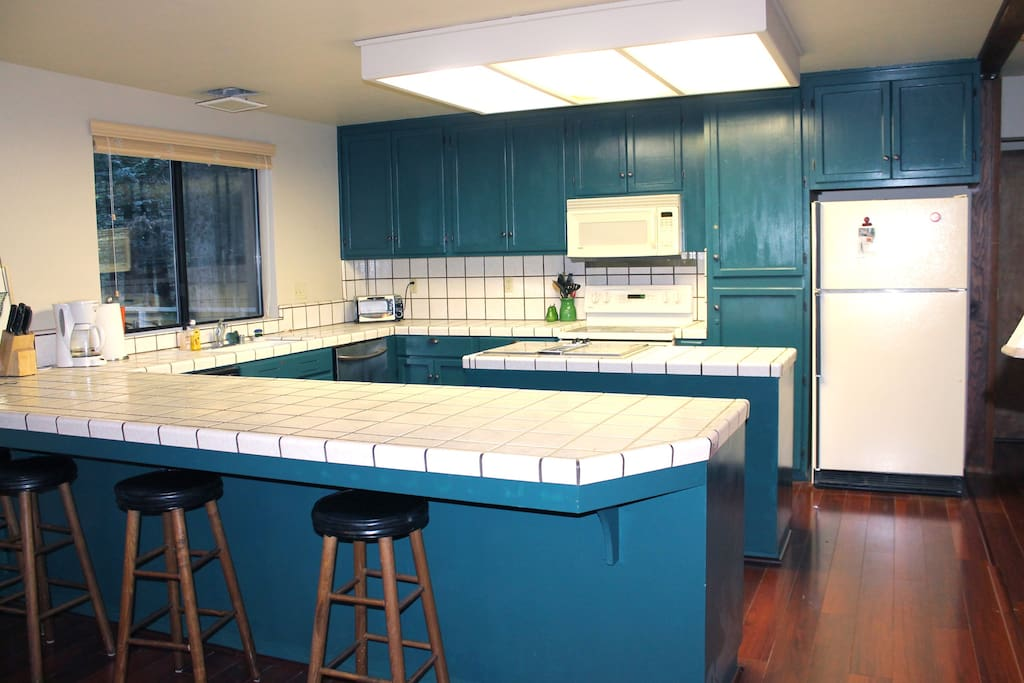 Large, open kitchen with counter seating.