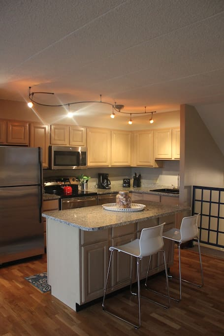 Remodeled kitchen and breakfast bar  with everything you need for your vacation - plates, cups, wine, beer, and champagne glasses, dishwasher safe plastic wear for kids and more!