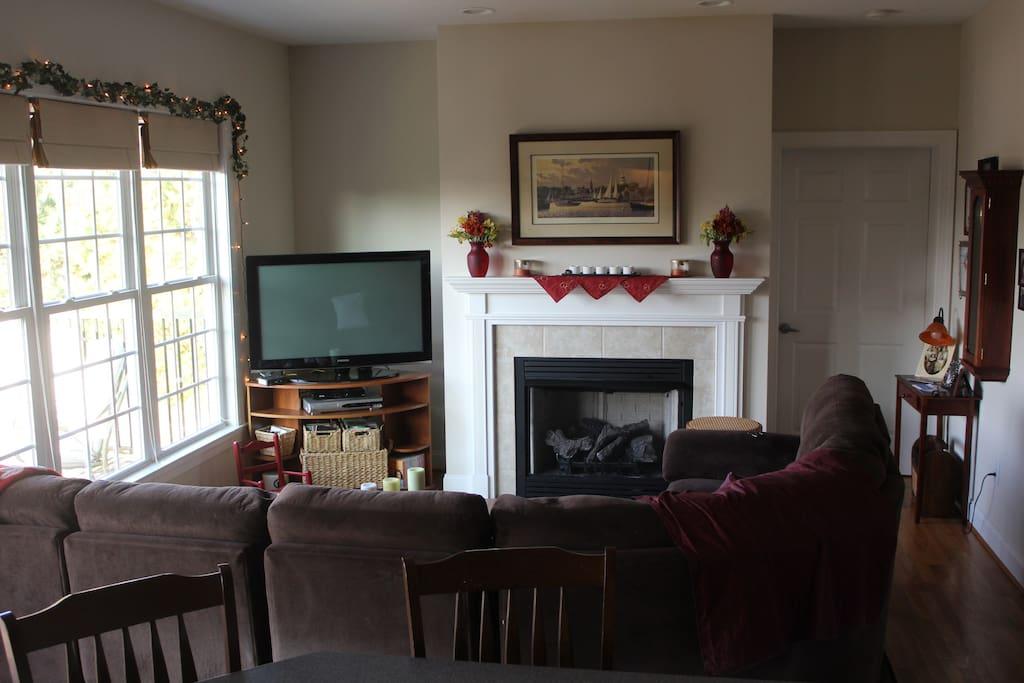 Spacious living room with abundant light.