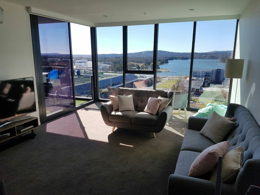 Living space with big screen smart TV, comfy couches and beautiful view
