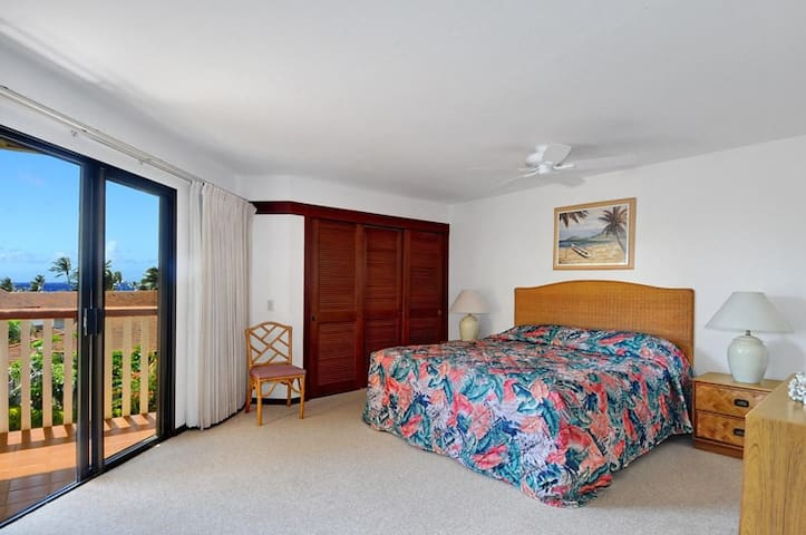 Master bedroom has bath attached, opens to LR and also lanai.   Has TV and safe large enough for several laptops