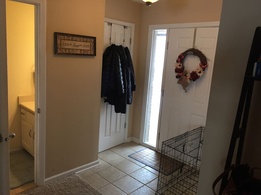 Entryway and guest bathroom. Dog crate will not be near front door during your stay.