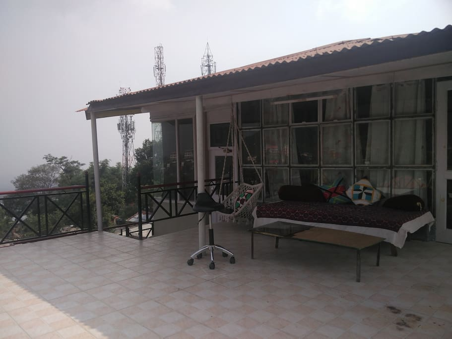 Spacious balcony with a cozy sitout and gorgeous unrestricted view of the mountains