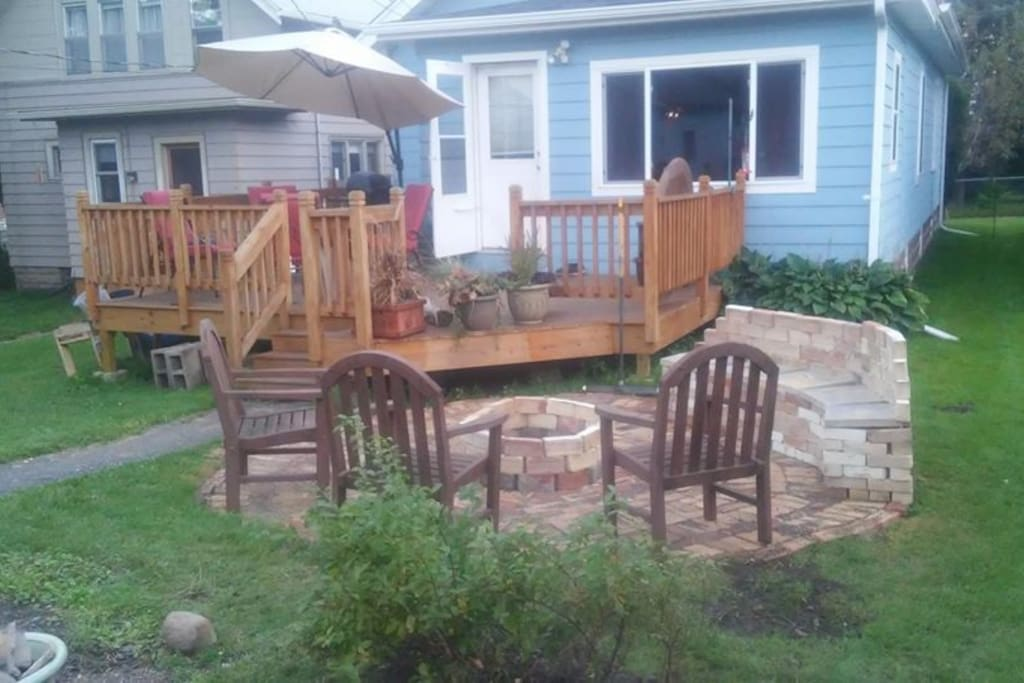 Backyard----guests are welcome to enjoy the grill, deck and firepit.