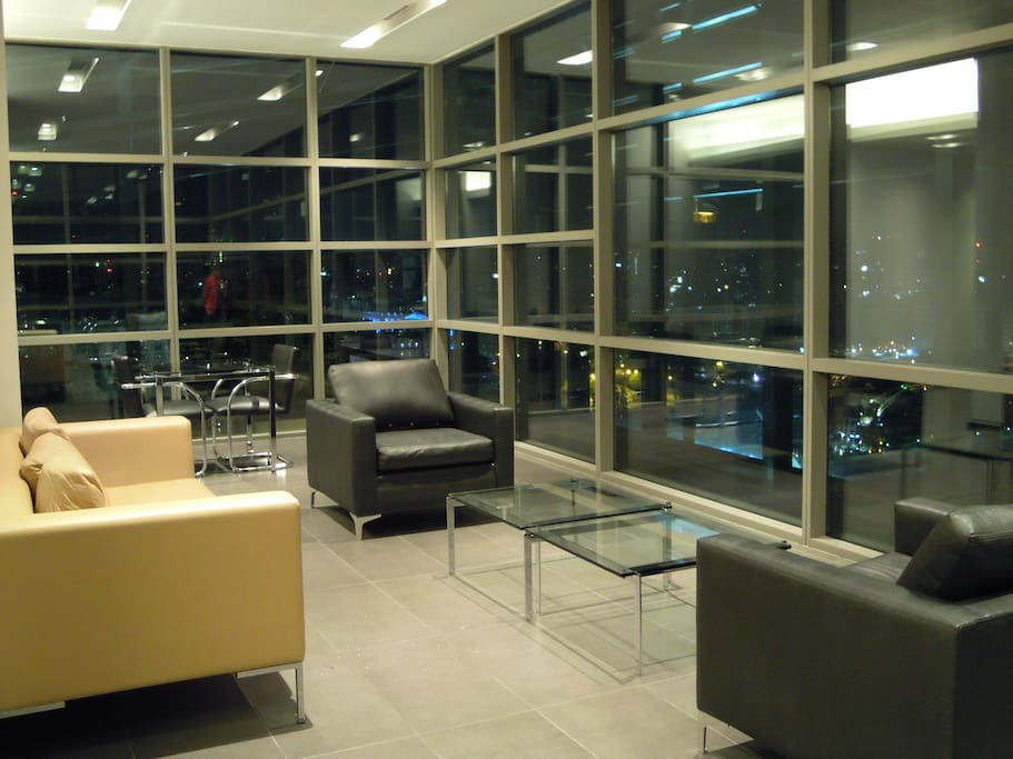 Building's top lounge at night