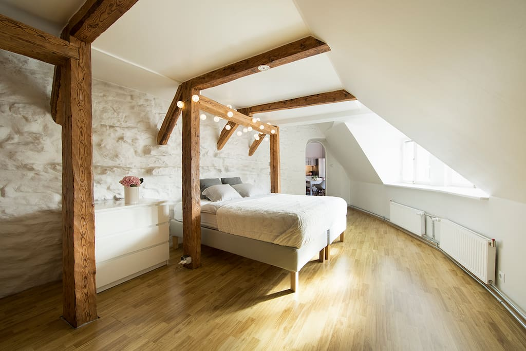 Romantic bedroom with the view over Niguliste church and  old town´s red rooftops.