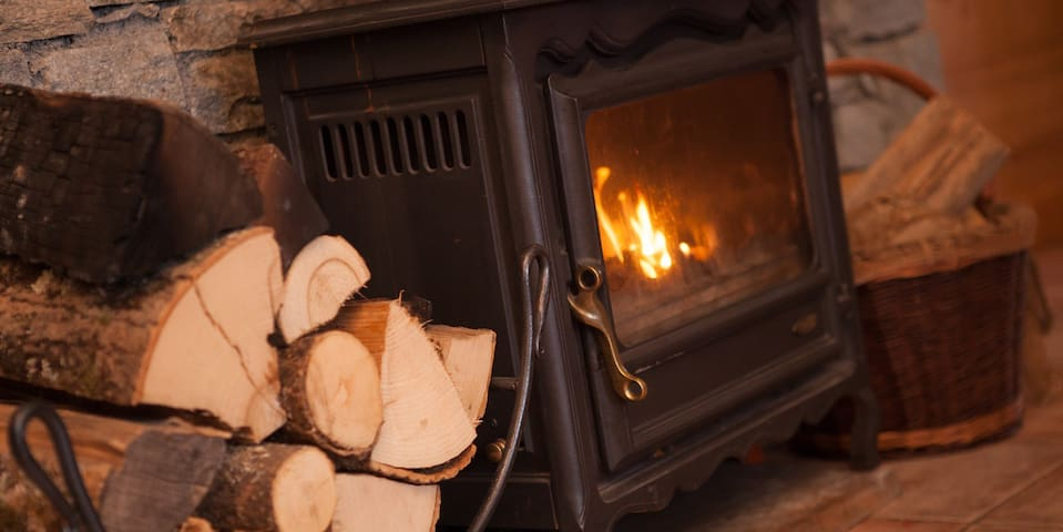 The wood-burning stove makes the living room cosy on chilly evenings