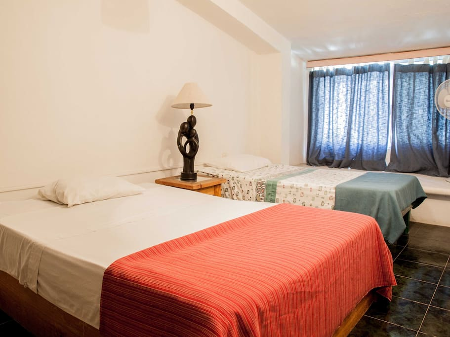 Twin bedroom with mexican decoration. It is light, comfortable, and cozy.
