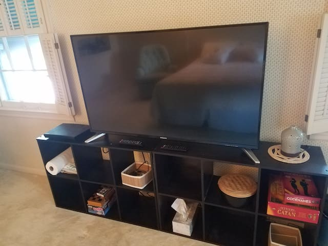 49' TV has a blueray player with Netflix/Hulu/Amazon etc. capabilities if you have an account to sign in. *No cable access. Also EO diffuser, games, tissues, etc...
