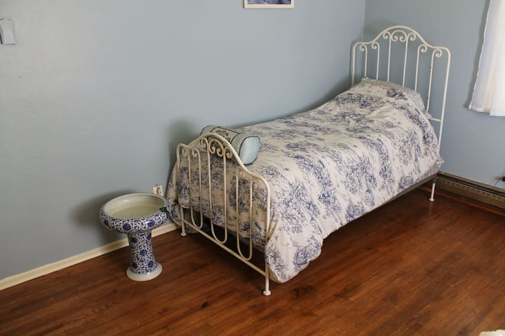 Twin bed with iron headboard