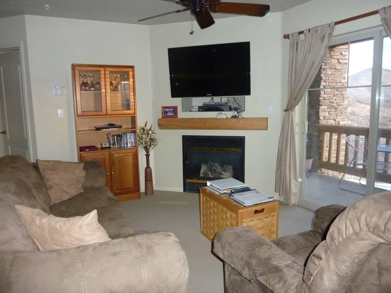 Living Room with queen size pull out couch and 46 inch HDTV