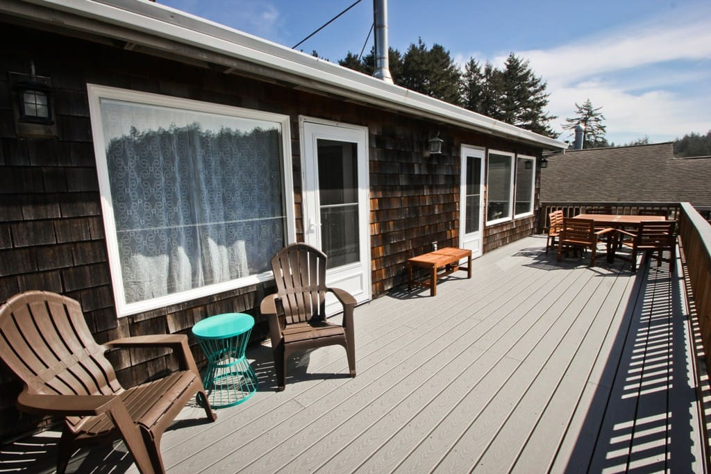 Large upper deck with patio table for 5, 2 lounge chairs, and ocean views