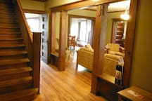 View of the stairway and living room from the foyer.