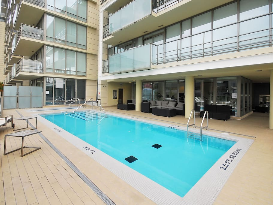 Outdoor pool open year round...adjacent to the fully equipped gym.