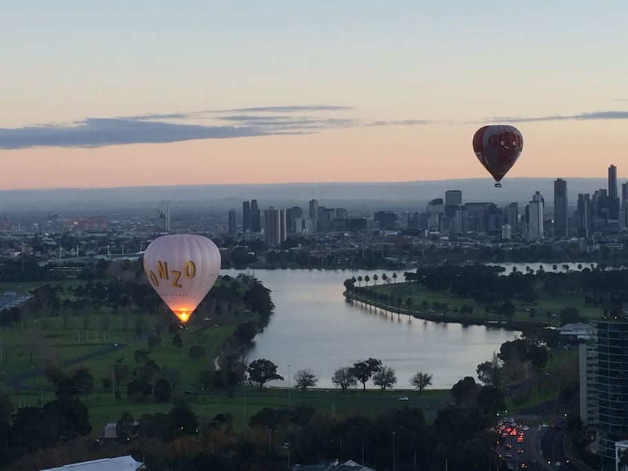 Spectacular and memorable scene of early morning hot air balloons with Melbourne city as backdrop.