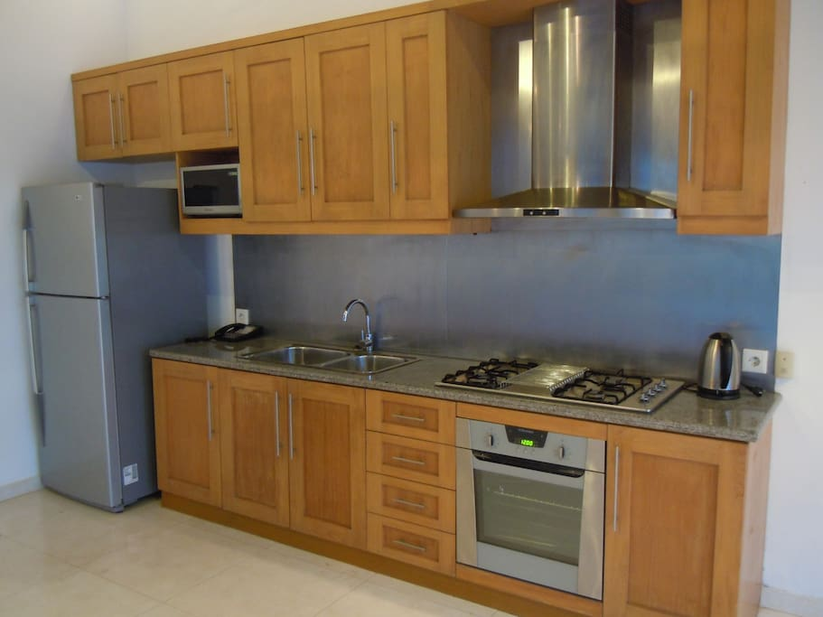 Full Kitchen with fridge and gas cooker/oven and microwave