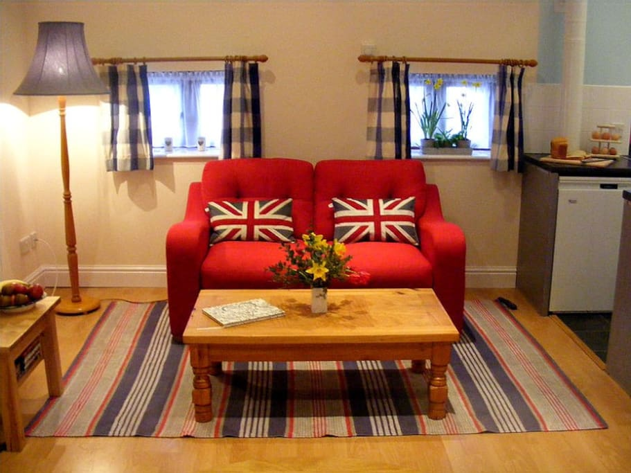 Cosy, cherry red sofa.