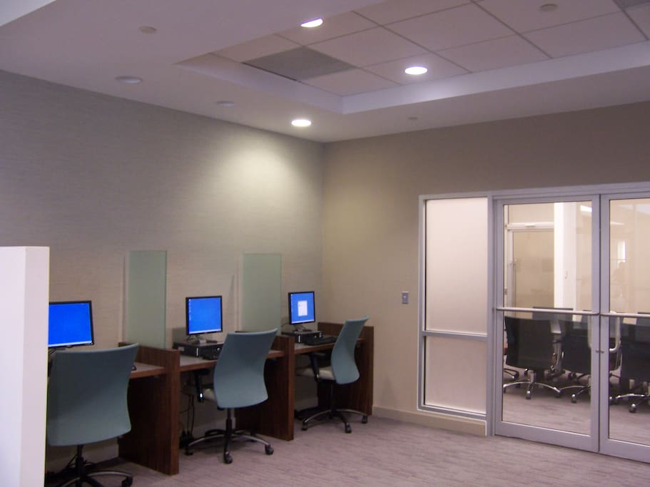 Business center with computers and printers for guest use.