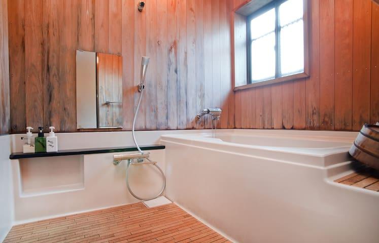 Cedar-walled shower room with soaking tub