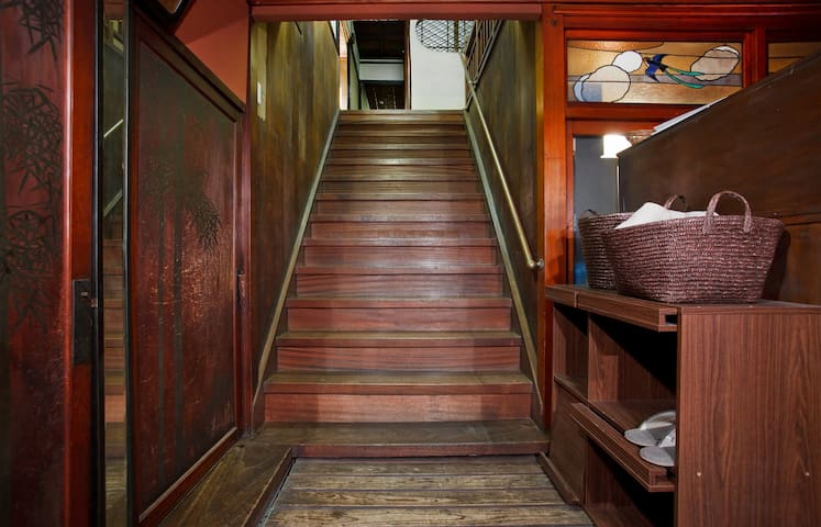 Staircase leading to the upstairs suite.  (There is usually a curtain plus a room divider here for extra privacy.)