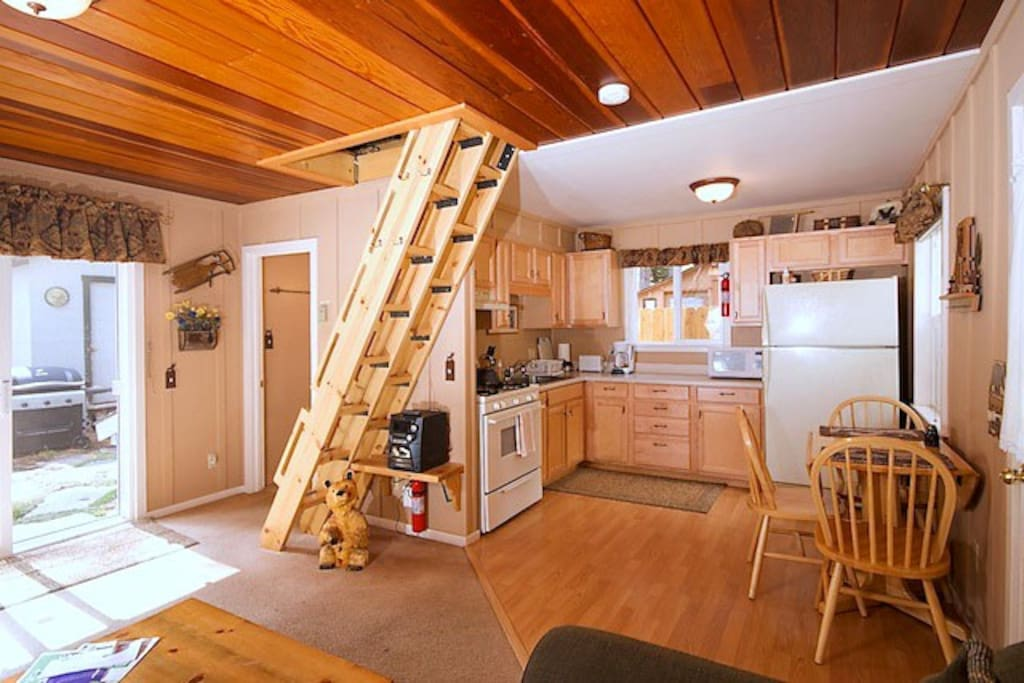 Kitchen with gas range, microwave, coffee maker, table seats 4 people.