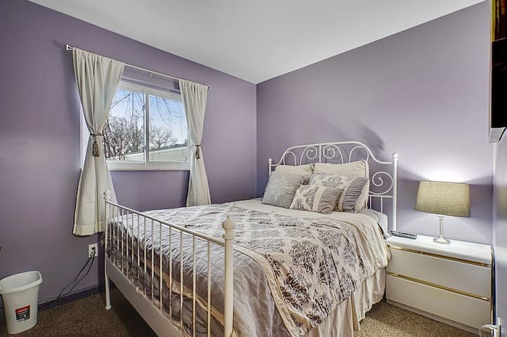 Cute Purple Bedroom with queen sized bed, new big LED LG TV, closet, night stand, table lamp, new comfy comforter and additional blanket