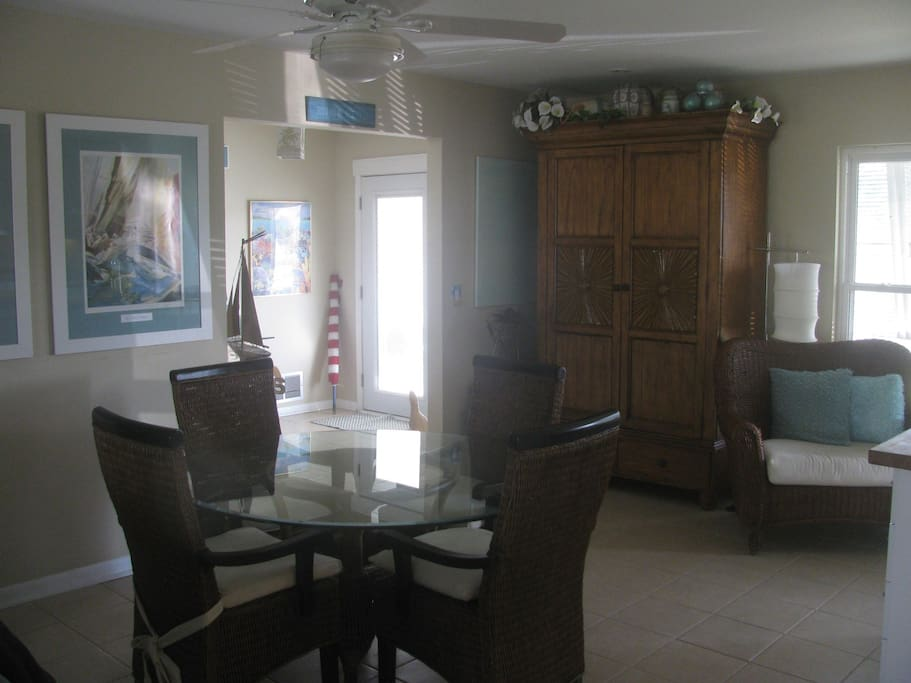 Dining room w/6 chairs, armoire is bar w/wine cooler.