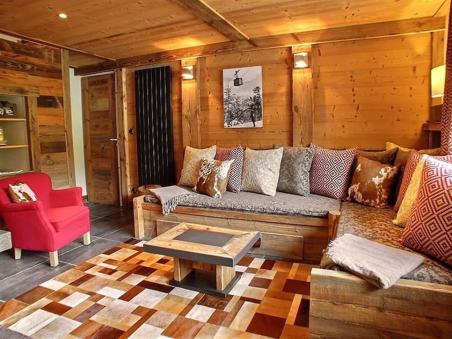 Coin salon avec canapé transformable en 2 lits simples