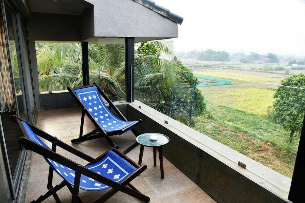Top room attached balcony with farm view