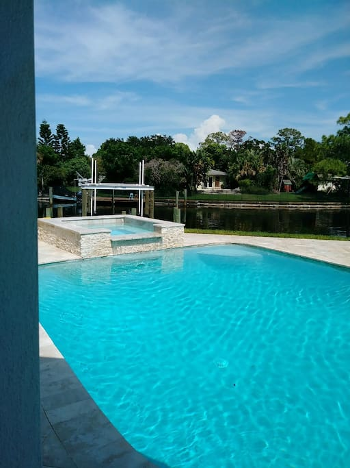 Watch the dolphins swim by or the big game on the outdoor TV while relaxing in the hot tub!