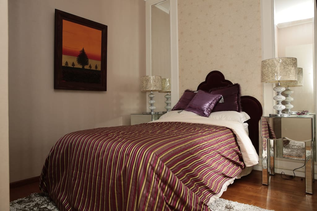 3rd Room Single bed with delicate decor