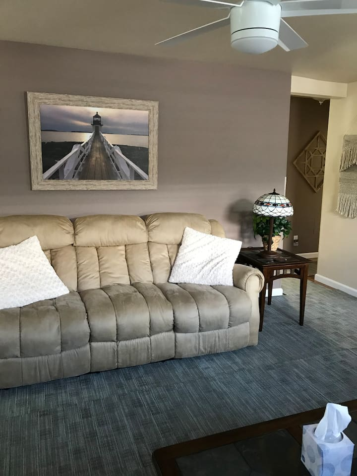 Super-comfortable reclining couch in living room.