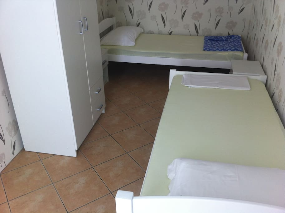 Second room with 2 single beds, which can be joined if needed