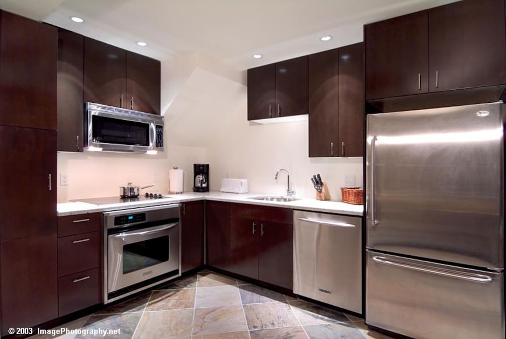Fully equipped kitchen, with stainless appliances, heated flooring