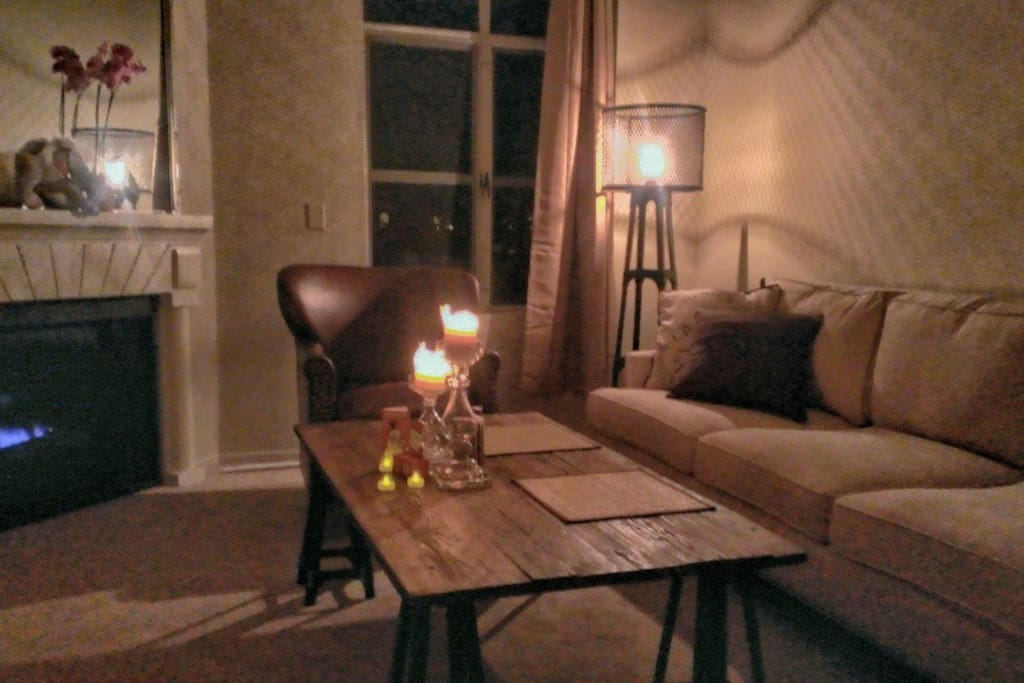 So relaxing at night! The kitchen is in the foreground and to the right; the bedroom and bathroom are behind the wall where the sofa is against