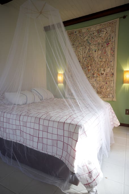 Bed with mosquito net (just in case)