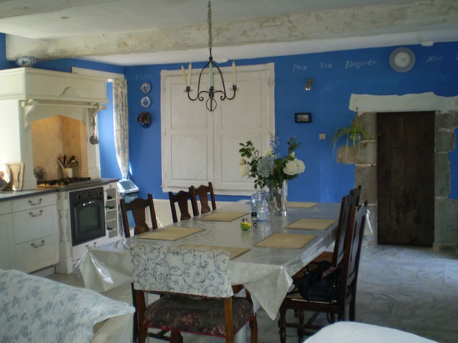 Large dining area and view of hob/oven of farmhouse kitchen
